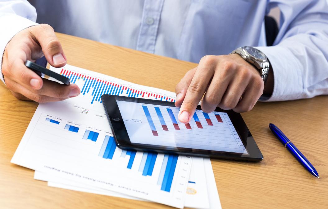 Dental practice owner reviewing RRSP graph on tablet