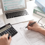 Accountant writing financial plan for dentist
