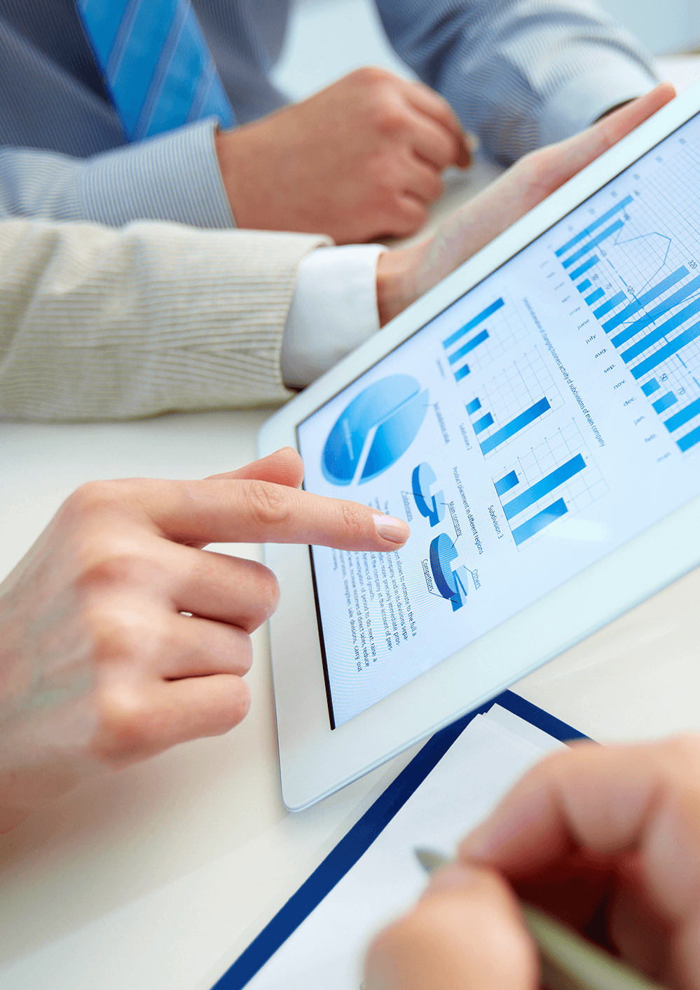 Group of accountants reviewing business plan on tablet