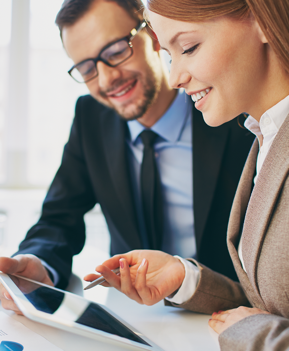 Business man and woman reviewing tax documents on tablet