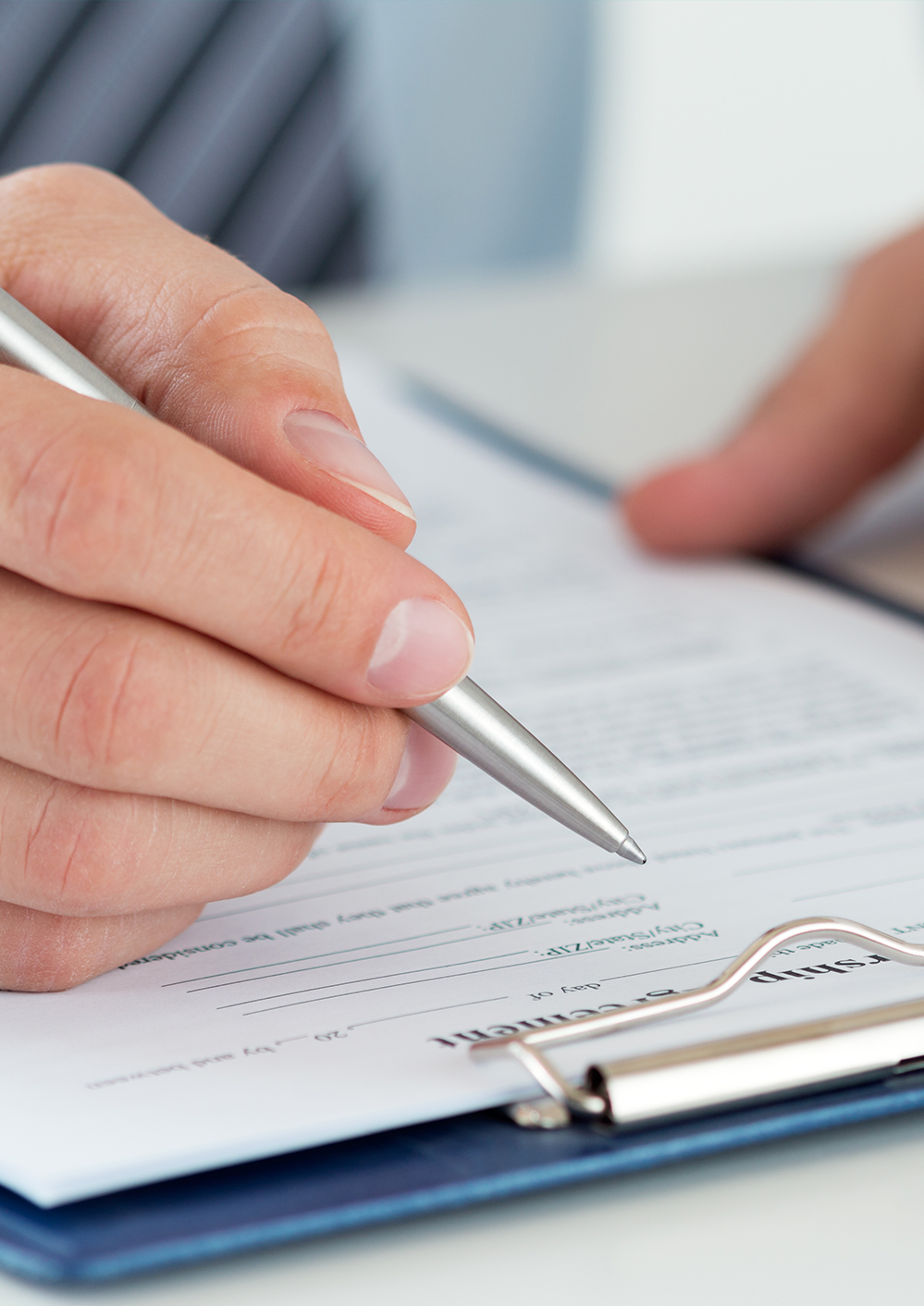 Close-up of accountant signing tax forms