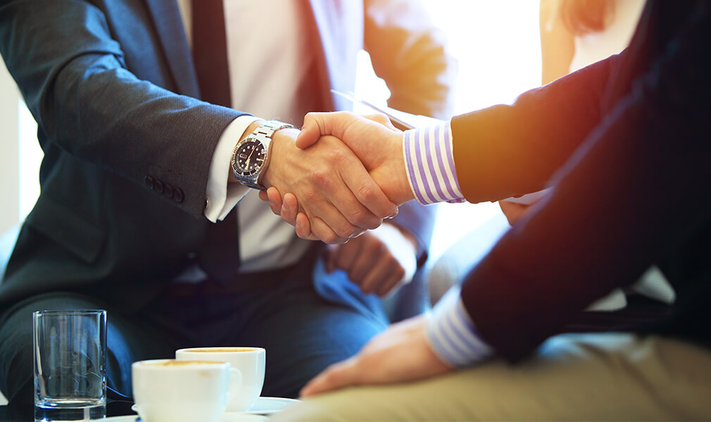 Life insurance salesman shaking hands with client