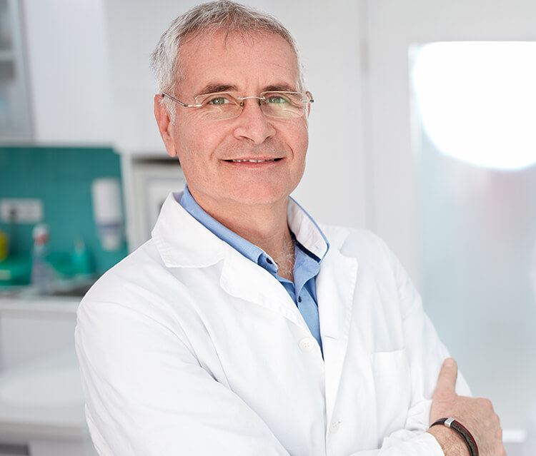 Retired dentist with grey hair and glasses