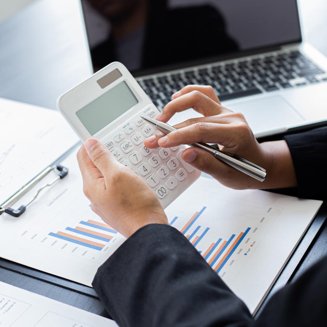 Tax accountant using white calculator